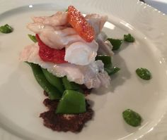 Steamed red bream with candy tomato, snow beans, black olives and green sauce