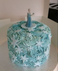 Amazing Elsa figurine on this Frozen themed cake!   By Cake Central user nataliacaley