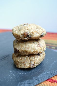 No-bake raw vegan oatmeal raisin cookies with shredded coconut and coconut oil.