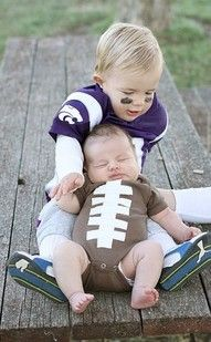 Too cute! Dad could be the football player, mom could be the football player. In fact you could recruit a whole team and pass the baby among you. But please, not throws and no tackles.