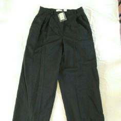 NWT Ann Taylor Light Wool Pants These black Ann Taylor trousers are made of 100% Wool with a lining of 100% acetate. They are lightweight and straight / wide leg. They are a size 10 with a pleated front and are new with tags. They have a 13 inch rise and a 26 inseam and measure 14 inches across the waist. Total length 39 inches. Ann Taylor Pants