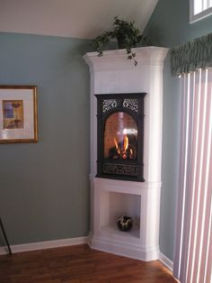 indoor space saving corner cabinet fireplace | Corner Fireplaces Give Rooms a Design Edge