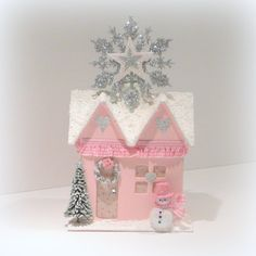 Pink Shabby Chic Christmas Cottage. This little cottage is painted pink with a glittered snow covered roof and a large silver glittered