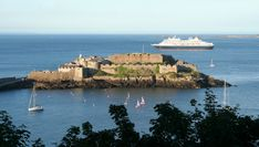 Author Anne Allen captures the spirit of Guernsey through her riveting book series, The Guernsey Novels.   Photograph of Castle Cornet in Guernsey. (Image Creative Commons Licence)