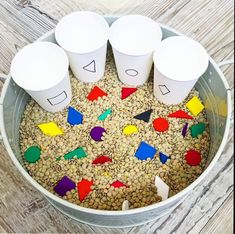 SHAPE SORT SENSORY TUB Here's a super simple sorting game using shapes and paper cups to sort them into. There are lots of colourful… Preschool Learning Activities, Infant Activities, Preschool Activities, Shape Activities, Sorting Games, Kids Education, Physical Education, Health Education, Kids And Parenting