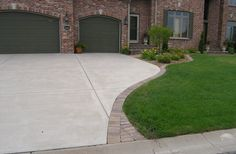 Concrete driveway accented with Brick Pavers to match landscape edging. Dress up the driveway. Driveway Edging, Brick Edging, Driveway Landscaping, Brick Pavers, Paver Edging, Paver Walkway, Driveway Ideas, Landscaping Ideas, Paver Sand