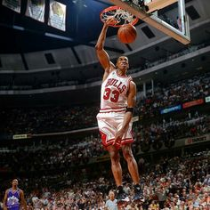 Scottie Pippen gets free from his primary defender Bryon Russell and the Utah Jazz for the dunk in Chicago.