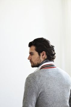 Henry Cavill, grey sweater, and that hair...eat your heart out Patrick Dempsey.