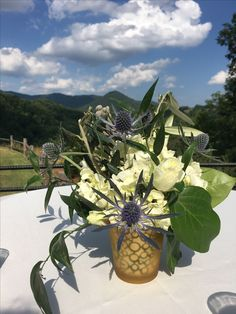 Table decor for cocktail tables at a beautiful summer wedding at Castle LadyHawke