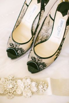 Black lace Jimmy Choo peep-toe heels: http://www.stylemepretty.com/2015/06/16/wedding-day-shoes-worth-showing-off/