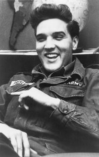 elvis. love to see him laugh!