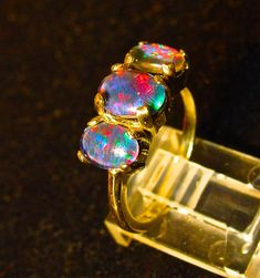 The Perfect engagement ring.Genuine Australian Opal ring.Three Australian Opals in 14K or a Sterling Silver setting.