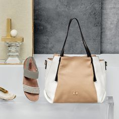Neutral colour palates blended with highlight colours set the tone this season. Matching your bag with your shoes has never been easier.  Our two tone HANDBAG 4375 by  PEPE MOLL and PISCES sandals by  MUNRO