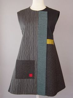 PP: Princess Line Vest in Blacks and Teal Accent This is probably my favorite all time style. Classic and hip at the same time. This long shaped vest flatters every figure. Japanese cotton with obsessive stitching, teal handwoven front band and gold accent. | I'm so copying this for winter, for wearing over my jerseys and leggings.