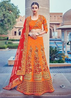 Buy party wear lehenga choli online for women. Grab this raw silk embroidered and patch border work a line lehenga choli for bridal and wedding.