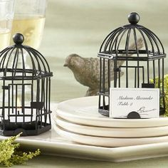 "Love Songs Birdcage soy Tea Light/Place Card Holder by EventFavor. $3.23. Birdcage measures 4 ¼ "" h x 2 ¾ "" in diameter. Tea light candle included. Finely detailed, hexagonal, black-metal birdcage with pop-open door and ""perch"" for place card. Place card with delicate bird design included. Reminiscent of an enchanting Victorian birdcage, Kate Aspen's ""Love Songs"" Birdcage Tea Light/Place Card Holder brings classic elegance to any event. This fabulous favor is..."