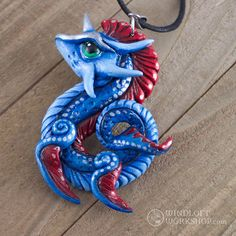 I've heard people say that red and blue don't go together, or that they're difficult to combine. I disagree, and have absolutely loved this combination wherever I find it! This dragon pendant has a real-life inspiration in the oarfish (amazing creatures!).