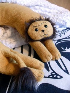 Rodger the Lion Travel Neck Pillow by ComfortbyFeliciaRose on Etsy, $35.00