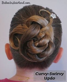 Curvy Swirvy Updo - This didn't come out quite like the picture, but I've only done it once.  I'll definitely try again, and I think it came out cute.