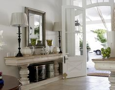 .Twin console tables flank the front door.