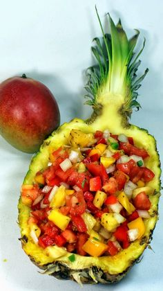 Pineapple Mango Pico de Gallo Salsa Recipe - I love the idea of serving this in a hallowed out pineapple! What a fun party appetizer.