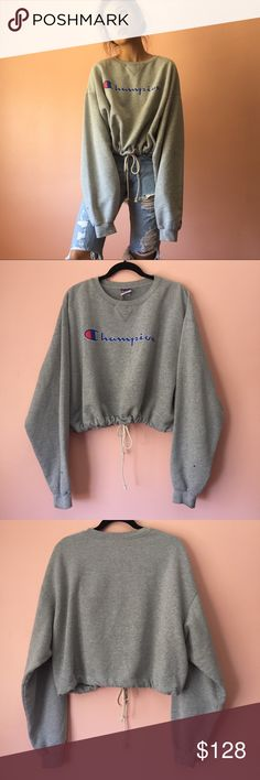 Vintage Champion Cropped Sweatshirt Break Instagram with this vintage deadstock Champion sweatshirt. Features a crewneck, super long sleeves, classic blue and red Champion logo, cropped silhouette and rad drawstring waist in heather gray. Wear everyday. Fits oversize. Good vintage condition with marks and distressing on sleeves. No returns allowed. Please ask all questions before buying. IG: [at] jacqueline.pak #vintage #champion Champion Sweaters Crew & Scoop Necks