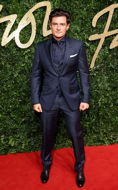 Orlando Bloom from 2015 British Fashion Awards Red Carpet Arrivals  In a navy tuxedo
