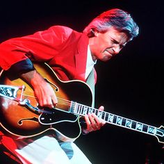 "John McLaughlin was invited to record w/Miles Davis while still in his 20s, co-parenting jazz fusion on Bitches Brew. But he achieved guitar-god status w/his own Mahavishnu Orchestra, where he made his Gibson spit fire like a many-headed dragon. A breakneck stylist, McLaughlin was peerless, mixing psychedelic rock/R/gypsy jazz/flamenco/Indian raga techniques. That polyglot mastery earned him huge respect from jazz and rock peers alike: Jeff Beck called him ""the best guitarist alive."""