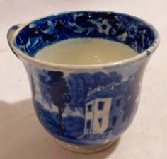 """Bodner's - NJ Historical Collection of William Kazar 12/3/16 Lot 456.  Estimate: $200 - $300. Realized: $250.  Description: Early 19th c. Historical Blue Staffordshire handled tea cup. Unmarked, Hoboken in New Jersey by Joseph Stubbs. Measures 2 3/4"""" tall x 2 3/4"""" in diameter."""