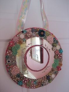 Vintage jewelry mirror!  Great idea for vintage brooches, earrings and beads!  We have lots of vintage jewelry at www.hendersonmemories.com