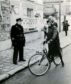 Jeanne Moreau rides a bike.    Jeanne Moreau, Diary of a Chambermaid Luis Bunuel 1964