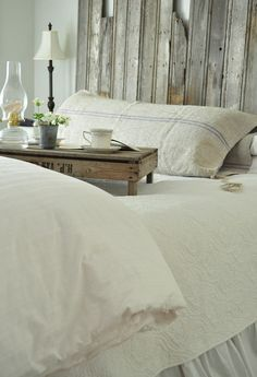 Old paneling as a headboard.  Love the pillow here.