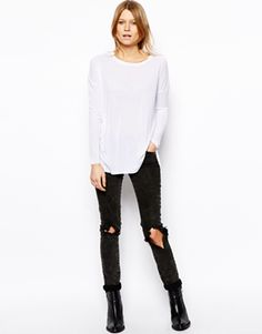 Image 4 ofASOS Long Sleeve Top with Curved Hem in Rib