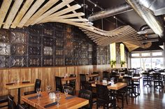 Reclaimed barn flooring forms a swooping sculpture, reclaimed tin clads the walls in this Waterloo restaurant.