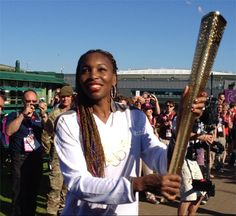 Venus Williams carries the Olympic Torch through Wimbledon