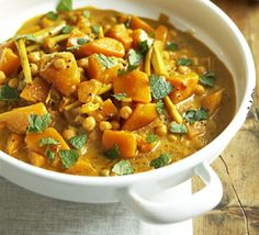 Pumpkin curry with chickpeas. A veggie dinner party dish which stands alone as a vegan main course or as a complex side dish perfect served with spiced roast meat or fish