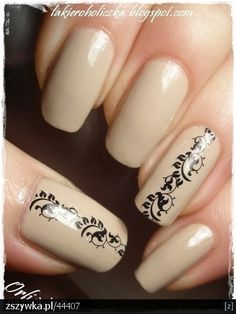 Simple nude / beige nails with black decorations