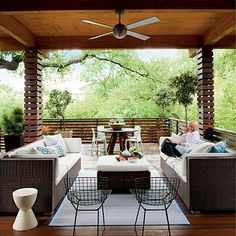 Indoor outdoor living. Not my style of furniture but LOVE the windows and nature and wood!