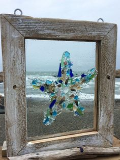 (My step sister did this)One of a kind mosaics made with buttons, beads and doodads!How to make sea glass window art – ArtofitStunning useful tips modern coastal industrial coastal kitchen cottage coastal bar nautical coastal garden design coastal Sea Glass Crafts, Sea Crafts, Sea Glass Art, Glass Beach, Seashell Art, Seashell Crafts, Mosaic Art, Mosaic Glass, Stained Glass