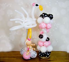 Stork with Pacifier topiary and Baby girl.  Decor by Balloon Brigade.