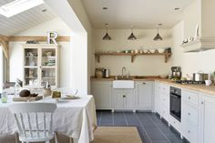 The oiled Oak worktops in this deVOL Shaker Kitchen give a country feel and look…