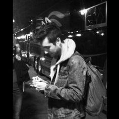Dan Smith - Bastille signing something