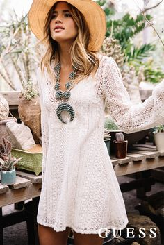 Get Rocky Barnes' LA style with a long-sleeve white crochet dress and boho accessories. Shop her summer look here. #LoveGUESS