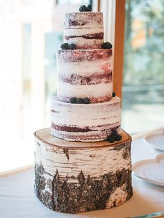 Display your wedding cake on a natural birchwood stand for a rustic, woodland-inspired presentation.