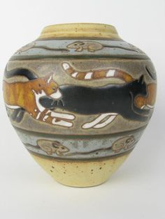 Ceramic Pottery Vase with Cats made by Suzanne Kraman. Description from pinterest.com. I searched for this on bing.com/images