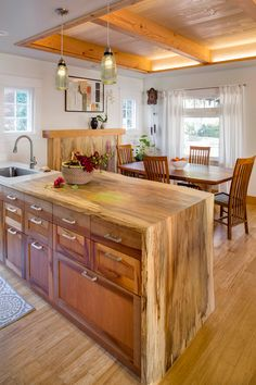 Kitchen Remodeled With Pacific Madrone Custom Cabinets. A Portland Salvage  Beech Tree Was Used For Photo