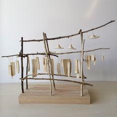 Aaron Kllc - ceramic and twig sculpture by Aaron Kllc