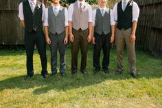 Mismatched groomsmen with gray ties