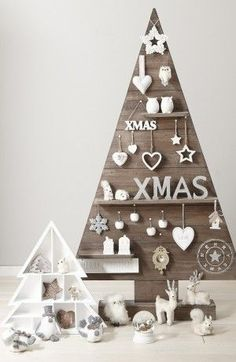 Oh wow, this wooden Christmas tree, decorated in white ornaments, looks heavenly.