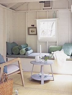 Great for a cottage. Who says a window seat needs to be all about the window? Continuing my love for these sunny spots to sit, read, lounge :) Beach Cottage Style, Coastal Style, Coastal Living, Coastal Decor, Beach House, Mini Loft, Shed Makeover, Sea Glass Colors, Beach Cottages